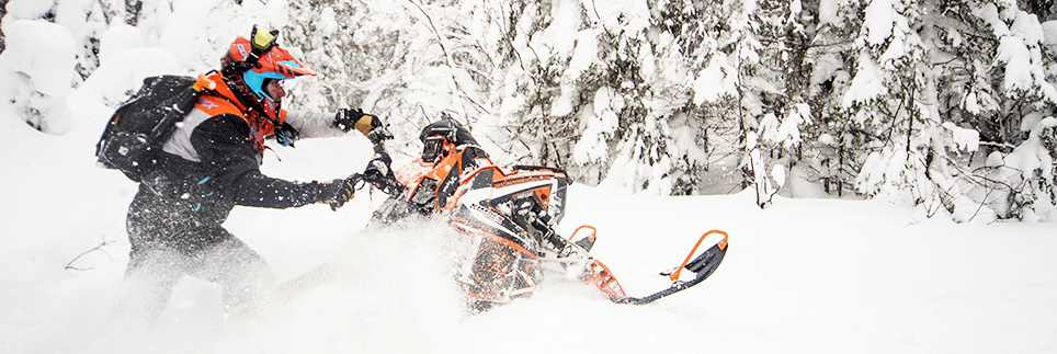 image of man on snowmobile